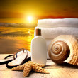 Beach accessories with a golden sunset — Zdjęcie stockowe #3348414