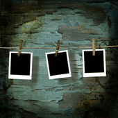 Polaroid pictures against old crackled backdrop — Stock Photo