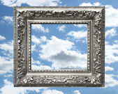 Silver picture frame against a blue sky — Stock Photo