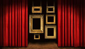 Gold frames with red drapes — Stock Photo