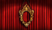 Red drapes with old gold frame — Stock Photo