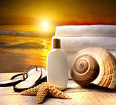 Beach accessories with a golden sunset — Stok fotoğraf