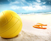 Volleyball in the sand with sandals — Zdjęcie stockowe