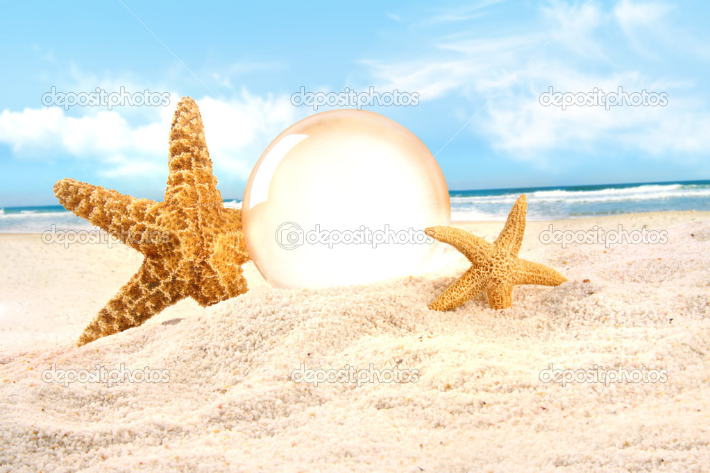 Crystal ball with starfish in the sand  Foto Stock #3348448