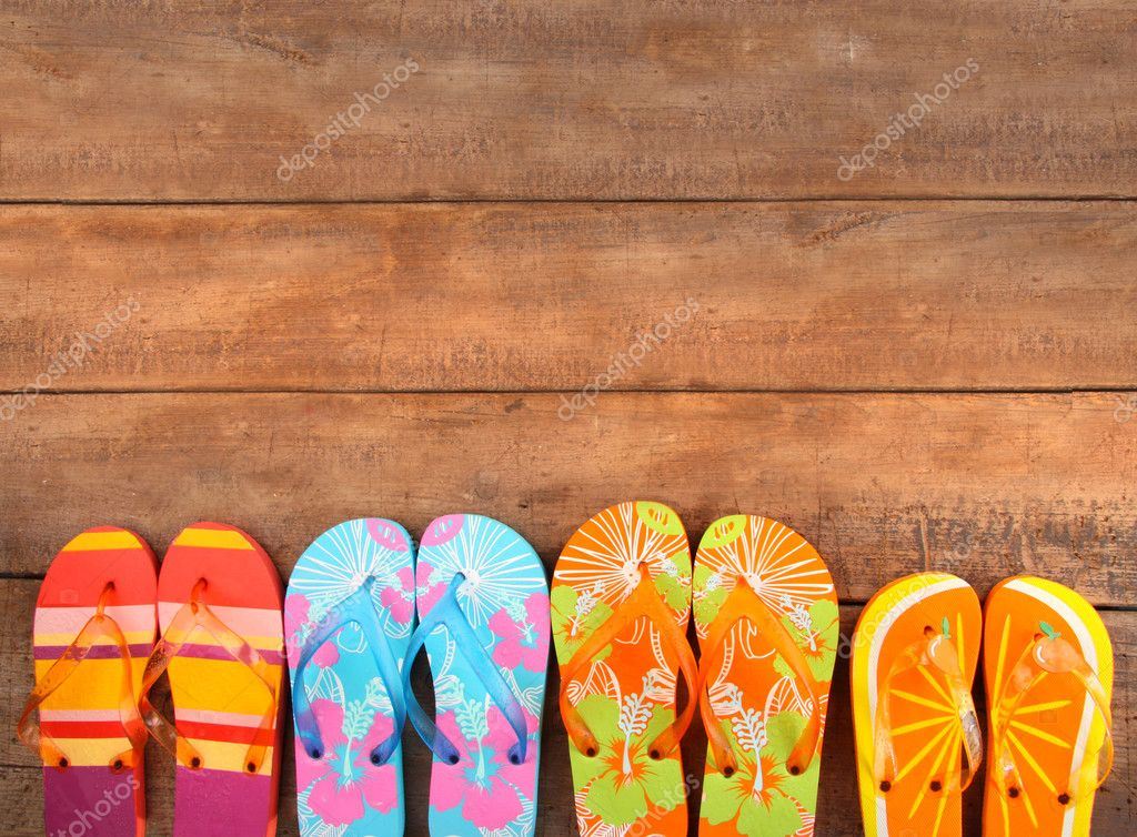 Brightly colored flip-flops on wood deck — Stock Photo #3348468