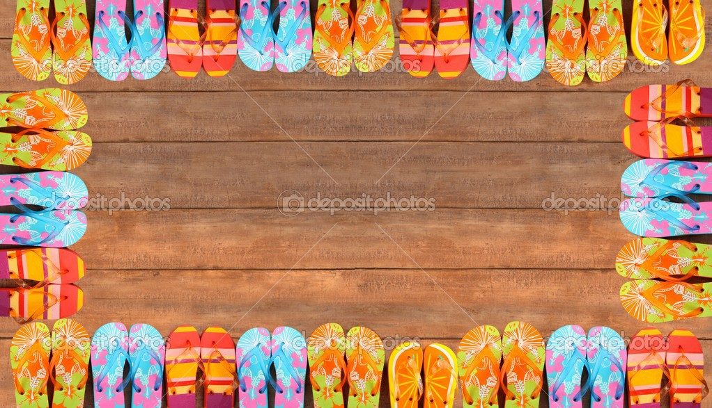 Brightly colored flip-flops on wood deck — Stock Photo #3348472