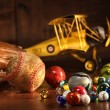 Old baseball and glove with antique toys - Stock Photo