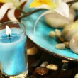 Blue aromatherapy candle and spa stones — Stock Photo