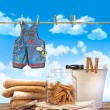 Laundry day with towels, clothespins on table — Stockfoto #3390163