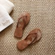 Flip flops with towels on seagrass rug — Stock Photo