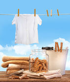 Laundry day with towels, clothespins on table — Stock Photo