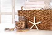 Closeup of laundry basket with fine linens — Stock Photo