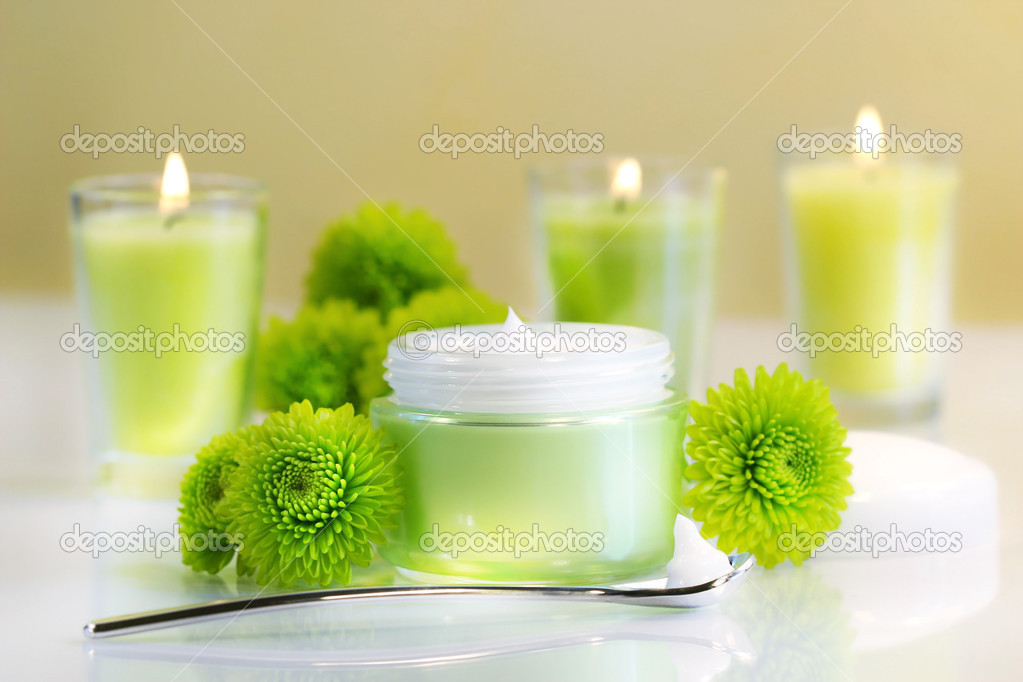 Moisturizing face cream with candles — Stock Photo #3390023
