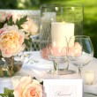 Place setting and card on a table - Stock Photo
