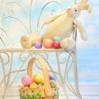 Easter bunny with eggs on chair - Stock Photo