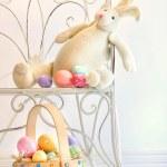 Stuffed rabbit on iron chair — Stock Photo
