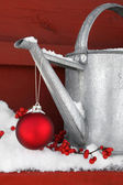 Red ornament on watering can — Stock Photo