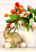 Little rabbit behind white container — Stock Photo