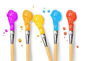 Bristle brushes full of different colored paints — Stock Photo