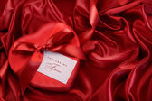 Box of chocolate with red ribbon — Stock Photo