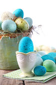 Easter scene with turquoise speckled egg in cup — Stock Photo