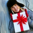 Girl holding Christmas gift — Stock Photo #3450114