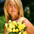 Pretty woman holding tulips — Stock Photo #3450135