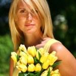 Pretty woman holding tulips — Stock Photo