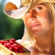 Woman showing a basket of berries — Stock Photo