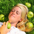 Young woman lying in the grass — Stockfoto