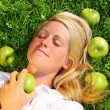 Stock Photo: Young woman lying in the grass
