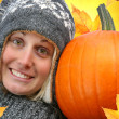 Girl with big pumpkin — Foto de Stock   #3450215