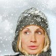 Young woman with snowy background — Stockfoto