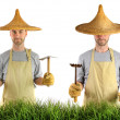 Man with Asian straw hat - Stock Photo