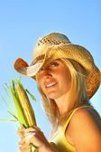 Pretty young woman holding corn — Stock Photo
