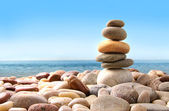 Stack of pebble stones on white — Stock Photo