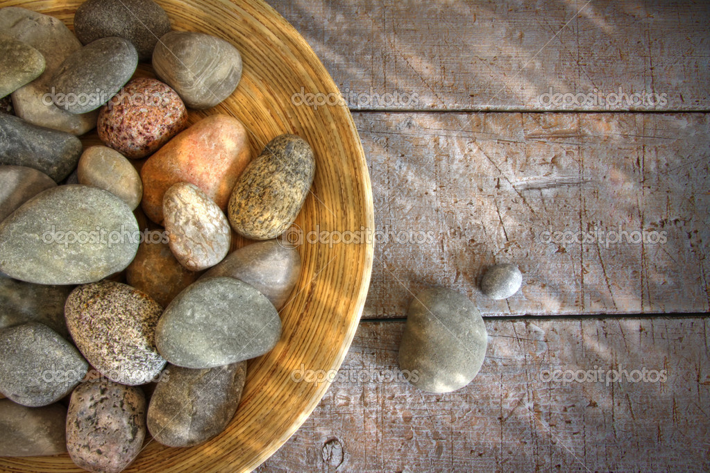 Spa rocks in wooden bowl on rustic wood table — Zdjęcie stockowe #3521371