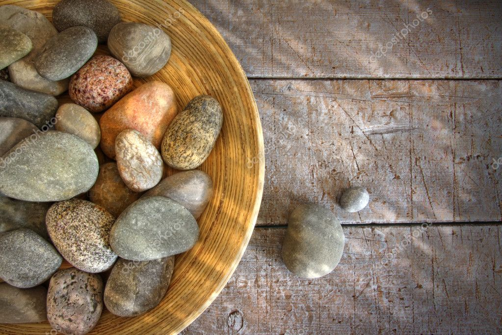 Spa rocks in wooden bowl on rustic wood table  Stockfoto #3521371
