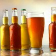 Glass of beer with bottles — Stock Photo #3620945