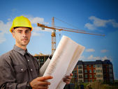 Young architect in front of building site — Stock Photo
