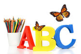 ABC letters with pencils on white — Stock Photo