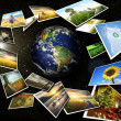 Several images streaming around the earth - Stock Photo