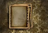 Vintage photo frame on floral background — Stock Photo