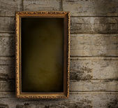 Old frame against a peeling painted wall — Stok fotoğraf