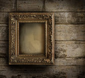 Old frame against a peeling painted wall — Stock Photo