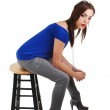 Young girl sitting on bar chair. — Stock Photo #3263547