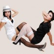 Two Chinese girls with hat. — Stock Photo