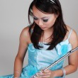 Chinese girl in dress with flute. — Stock Photo #3352645