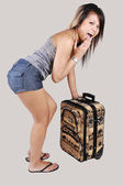 Asian girl with suitcase. — Stock Photo