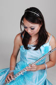 Chinese girl in dress with flute. — Stock Photo